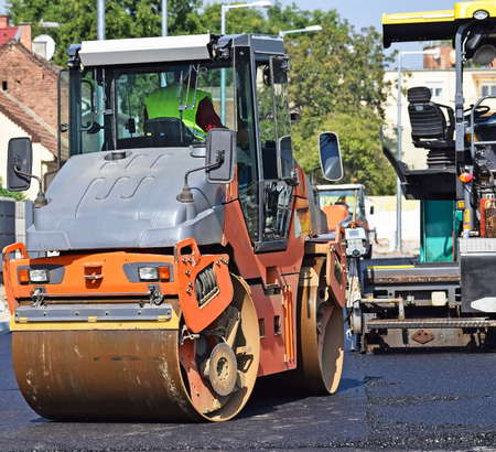 steamroller: Steamroller at the road construction in the city Stock Photo