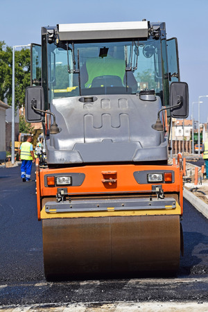 steamroller: Steamroller works at the road construction