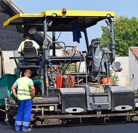 steam roller: Asphalt paving vehicle at the road construction