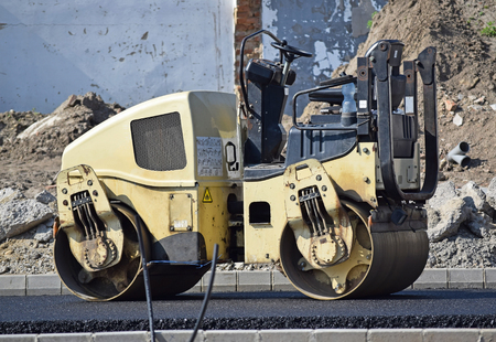 front end loader: Stam roller at the road construction Stock Photo