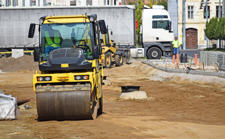 steam roller: Steam roller at the road construction in the city Stock Photo