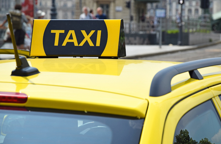 taxi sign: Taxi sign on the car