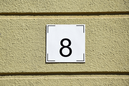 addresses: House number 8 on the wall