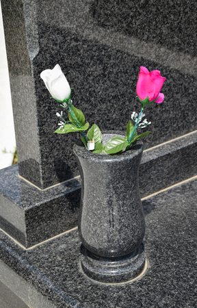 Vase with flowers in the public cemetery
