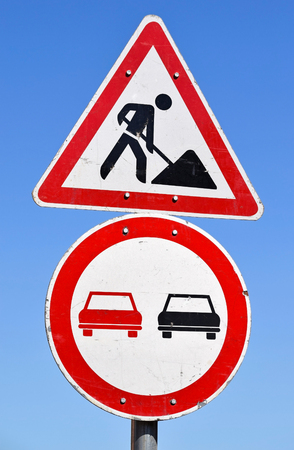 overtaking: Road works and no overtaking traffic signs Stock Photo
