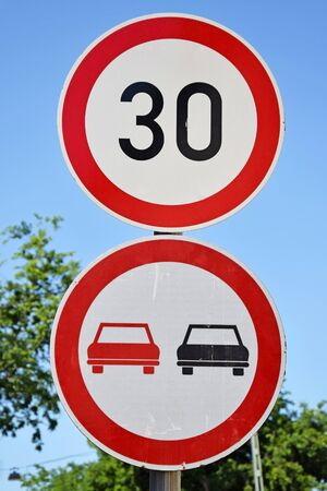 overtaking: Speed limits and no overtaking traffic sings Stock Photo
