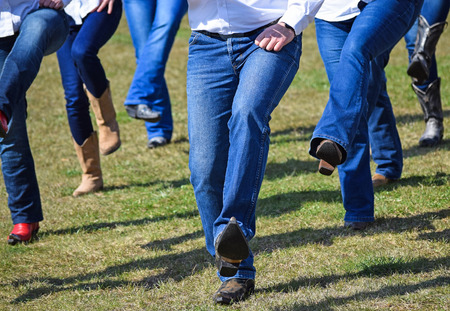 Western dancers show outdoors