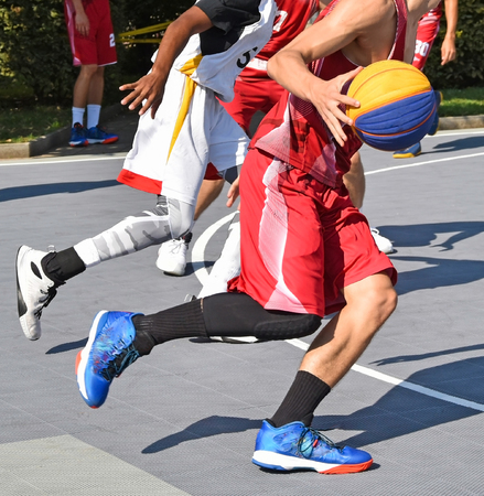 Basketball players outdoors in the city