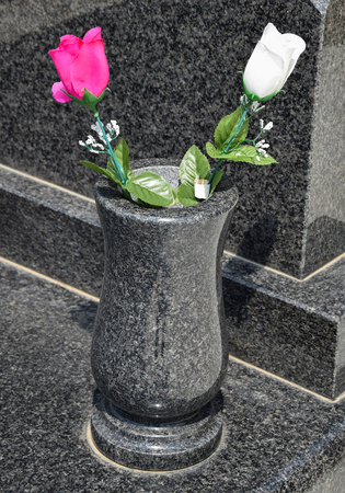 Vase and flowers on the tombstone