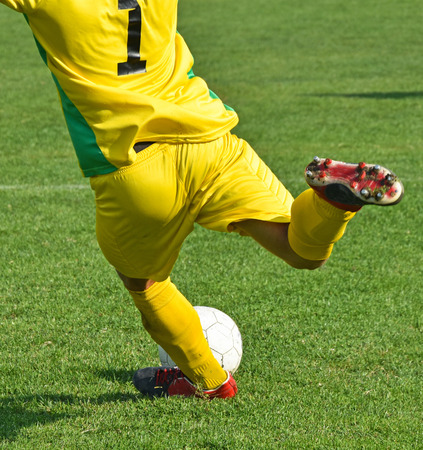 Soccer goalkeeper kicks out the ball Stock Photo