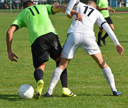 uniform green shoe: Soccer players in action at the match