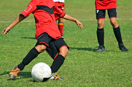 uniform green shoe: Kids are playing soccer Stock Photo
