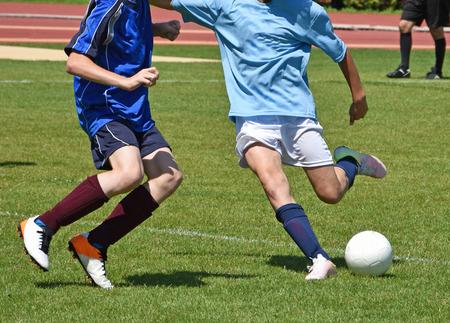 uniform green shoe: Kid soccer match in summer