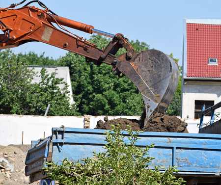Excavator at work at the road construction Stock Photo