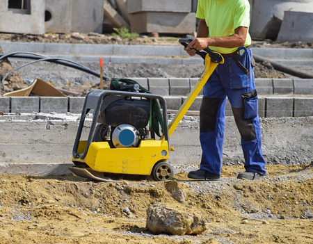 Working at the road construction in the city Stock Photo