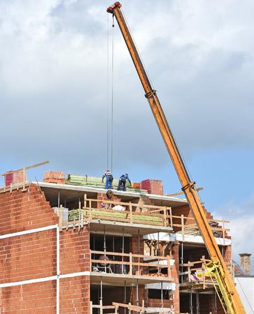 Crane at the apartment building construction Stock Photo