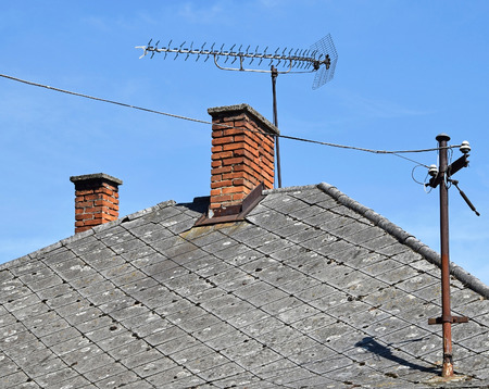 telephone poles: House with roof antenna