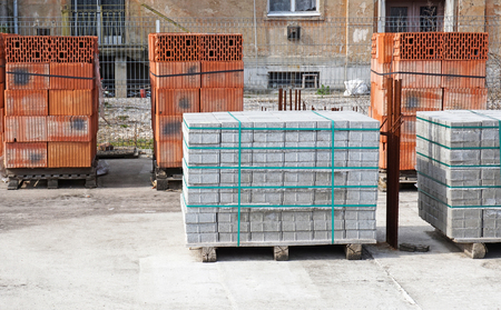 new addition: Brick and concrete construction materials at the construction site