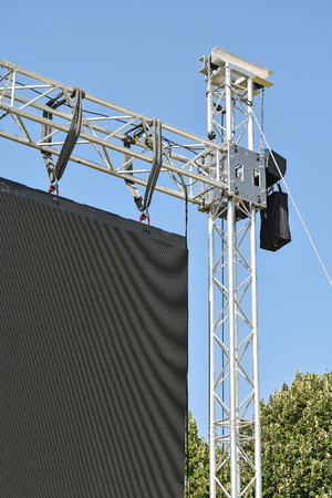 Baluster of a large LED screen outdoors against sky  Stock Photo