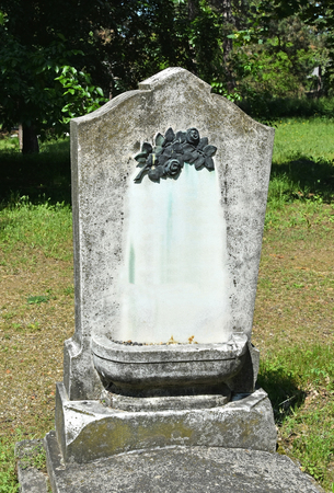 Old tombstone in the public cemetery Stock Photo