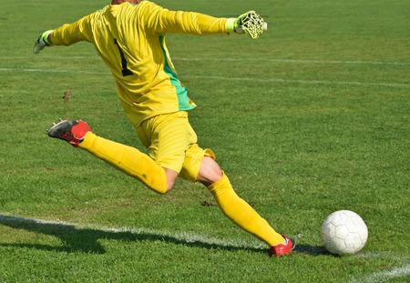 Soccer goalkeeper kicks out the ball  Stock Photo