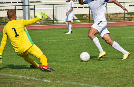 Soccer playar kicks a goal on a match Stock Photo