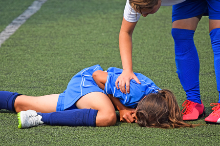 Injury on the women's soccer match Фото со стока - 77652798