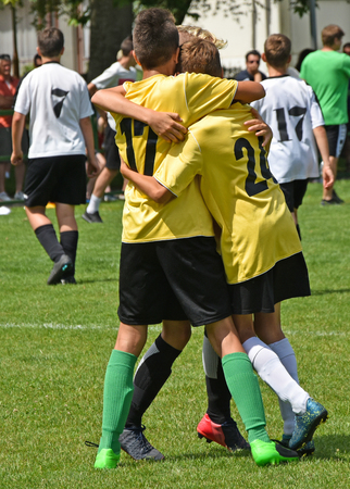 Young soccer players are happy after they won the match