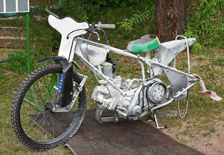 inoculation: Burned speedway motorcycle after inoculation