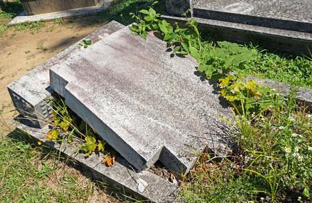 Broken tombstone in the public cemtery Stock Photo