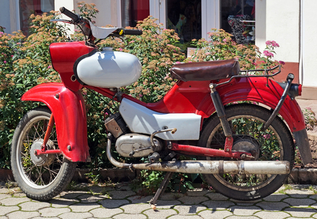 Old red motorbike on the street