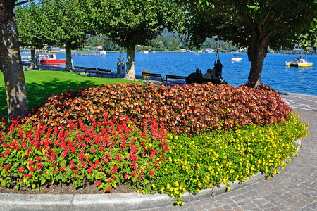 Park with flowers at the Lake Worth in Austria