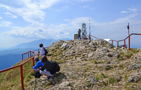 Tourists on the peak in the Carpathians, Romania