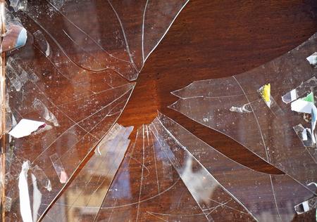 Broken shopwindow closeup in summer