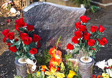 Flowers on the tombstone in the public cemetery