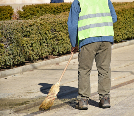Street cleaner at work on the road