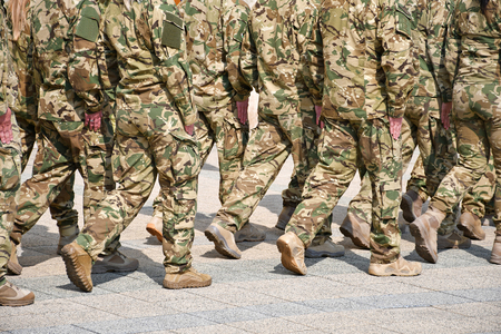 Soldiers marching on the street Stock Photo