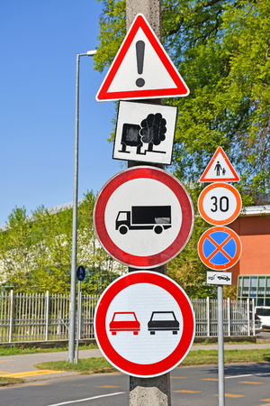 Traffic signs next to the street in the city Stock Photo