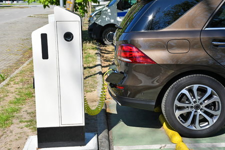 Electric car charging station in the parking lot