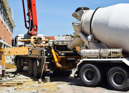 Cement mixer truck at the construction site 版權商用圖片