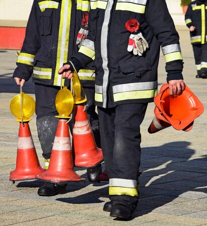 Firefighters with traffic cones at work