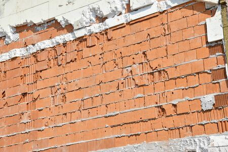 Brick wall of an apartment building under construction