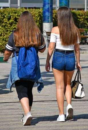Yong women walk on the city street