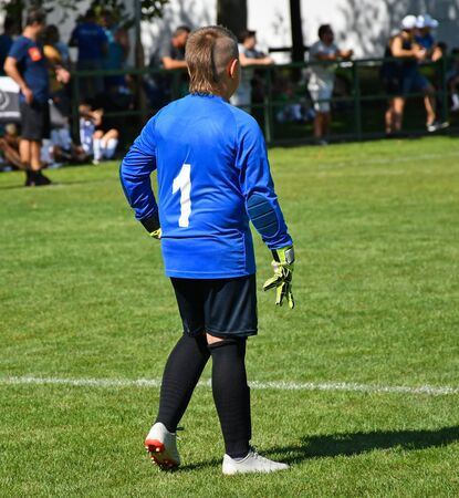 Young goalkeeper at the soccer field