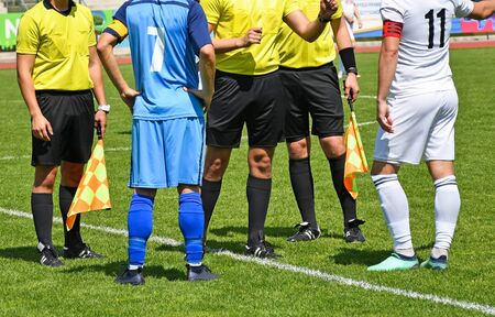 Soccer players and referees before match