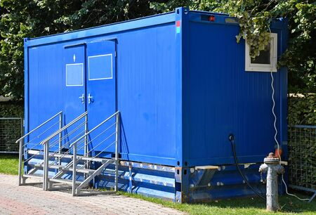 Toilet in a mobile container outdoors