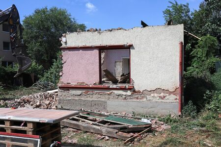 Demolition of an old ruined house
