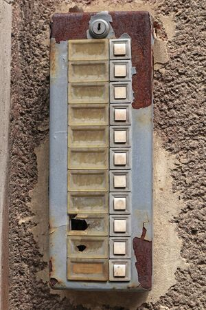 Old ruined dirty intercom on the wall