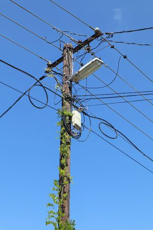 Old wooden street light pole with internet router Reklamní fotografie