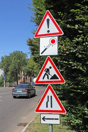 Road works and other traffic signs next to the road